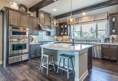Gray stained maple kitchen cabinets shown with mitered M101 – MW6, FP3/8  cabinet doors by TaylorCraft Cabinet Door Company