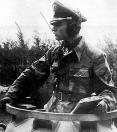 SS-Obersturmbannführer Max Wünsche, commander of the SS-Panzer-Regiment 12, in the turret of his Panther on 7 June 1944.