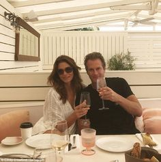 Cheers: Cindy Crawford uploaded this photo with husband Rande Gerber during their spring break vacation to St Barths
