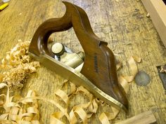 Lancashire rebate plane, It is a cast brass rebate plane with a skewed cutter. Instead of having a fence below the cutter (like a moving fillister plane), this plane has a sole that extends above the cutter and cutting surface.