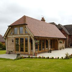 Outbuildings - Border Oak - oak framed houses, oak framed garages and structures. Lounge Decor, Border Oak, Cottage Extension, Oak Framed Buildings, Oak Frame House, House Extensions, Kitchen Extensions, Timber Frame Homes, Dream House Exterior