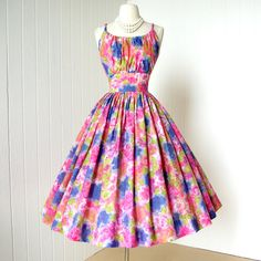 I would have loved to live in the 1950's so I could have worn dresses like this to garden parties or while vacuuming the house.  :)
