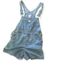 """Vintage Calvin Klein Overall Shorts Vintage Calvin Klein Overall Shorts // sz L // soft denim // small distressed hole near back belt loop: shown in last photo; easily patched / trendy style right now! // 100% cotton // hips measure between 19-19.25"""" / 11.5"""" rise up to bottom part of decoration on waist area / length 34.25""""/straps are adjustable // Can't model // 20% off 3+ Bundles // offers welcome// 4.28.57 *green color cast is from lighting No trades Calvin Klein Shorts Jean Shorts"""