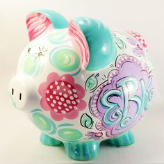Ceramic Piggy Bank. Hand Painted. Original design. Pinks and greens, florals and dots Custom orders welcomed. Include changes in the comments section or 'contact us' with a special request. Measures 8