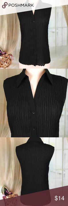 Nicola Black Crinkle Sleeveless Blouse Beautiful black sleeveless crinkle blouse. 100% polyester. Great condition.  Size L.  Bust measured flat armpit to armpit 16 inches in length 25 inches.  TP341 LOC-11 Nicola Tops Blouses