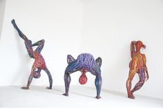 Hungary-based artist Judit Rita? Rabczky playfully molds strips of wire cables together to create her series of energetic human figures. She welds the colo