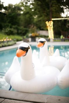 Inflatable swans are a great way to make an impression at your ugly duckling party! www.puppet.org