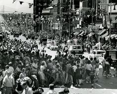 People flood into the street following the 1964 Days of '47 parade in Salt Lake City.