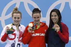 "Hungary's Katinka Hosszu (C) poses on the podium with silver medallist Britain's Siobhan-Marie O'Connor (L) and bronze medallist USA's Madeline ""Maya"" Dirado after she won the Women's 200m Individual Medley Final during the swimming event at the Rio 2016 Olympic Games at the Olympic Aquatics Stadium in Rio de Janeiro on August 9, 2016.   / AFP / Odd ANDERSEN"