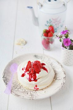Pavlova! This dessert is truly decadent! With meringue at the bottom, velvety cream in the middle, sweet gariguettes garden strawberries (one of the best varieties in France, yummy!) on top, and a bit of coulis, it is simply divine!