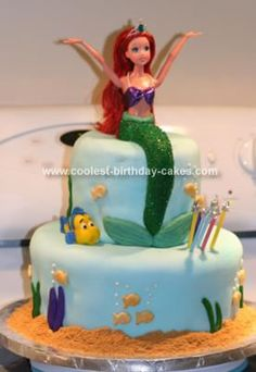 Homemade Ariel Birthday Cake: I made this Ariel cake for my daughter's friend's 5th birthday party. I baked two round 10 cakes and two round 6 cakes and covered them with marshmallow