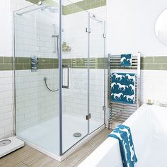 Break up an all-white scheme with two rows of green tiles.
