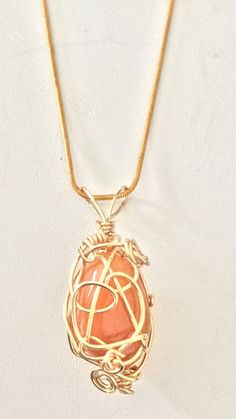Coral colored wrapped stone pendant necklace. by TROPICALNecklaces