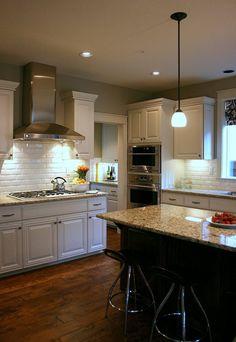 kitchen -  subway tile backsplash (bevel) and rustic wood floors