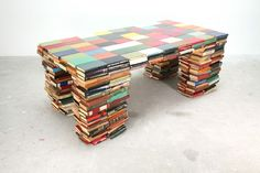 "Richard Hutten, designer had this piece as part of a collection called ""Layers."" The legs are composed by layers of books, piled upon each other. It is probably the piece that explains the philosophy behind the collection best. ""A book is all about layers,"" Hutten comments, ""layers of meaning."""