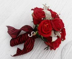 red roses and white calas