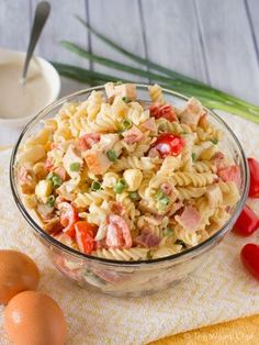 Cool down on a hot day with this creamy chicken Caesar pasta salad recipe loaded with chopped bacon and eggs!