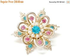 vintage pink and aqua rhinestone and gold atomic starburst brooch retro antique snowflake fashion pin (14.44 USD) by PlasticPinkFlamingos