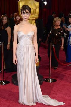 The Oscars 2014  How I Met Your Mother actress Cristin Milioti nods to bridal in a strapless chiffon Reem Acra dress.