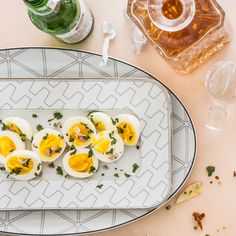 You can cook the eggs a day ahead (keep them chilled), but don't slice until the first guest rings the doorbell.
