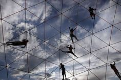 Burners hang off an art structure high over the Playa at Burning Man at Black Rock, NV., on September 2, 2009. Photo: Frederic Larson, The Chronicle