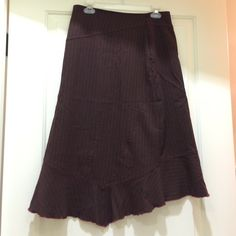 Neesh by DAR midi skirt Fun asymmetrical midi skirt by Neesh by DAR. Maroon with red stripes. Fabric is a soft polyester, rayon and spandex blend, so has some stretch. Moves wonderfully. Has some pilling but is in good condition. Size small. Neesh by DAR Skirts Midi