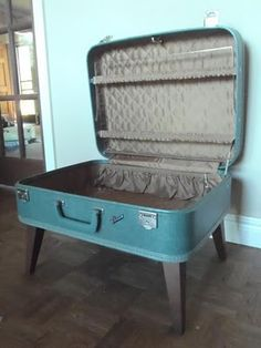 repurposed vintage suitcase into table - storage. just love it! use for Owens toy box