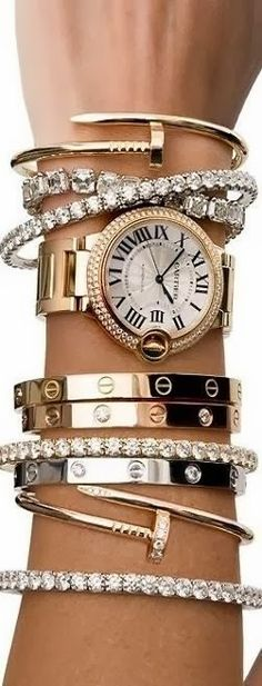 Cartier stack bracelets and watch for ladies | Fashion World http://www.thesterlingsilver.com/product/citizen-silhouette-crystal-womens-quartz-watch-with-analogue-display-and-stainless-steel-gold-plated-bracelet/