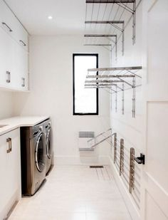 You could do some serious laundry drying in here with these steel fold out drying racks. Try not to poke your eye out though. |  Maple Leaf Custom Homes