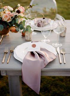 elegant wedding place setting with wax seal escort card