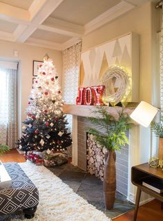 an ombre white to black christmas tree with lights, white rhomb ornaments and red baubles