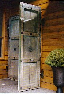 Rustic front door - I like it out back