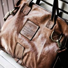 Vintage looking messenger bag in weathered camel colored leather