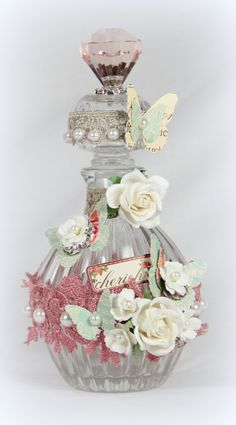 Altered bottle...butterflies and flowers
