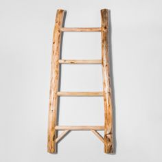 Bring a rustic touch to your home by adding in with this Wood Ladder Figure from Threshold™. The smooth, natural wood finish warms up any room in your home, whether you're displaying it in your entryway or using it in your living room. Hang decorative accent blankets from each step for a practical yet stylish way of decorating.