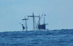 Square rig below the horizon - looks like pirates