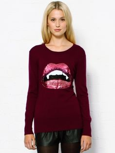 Markus Lupfer Vampire Lips Sequin Sweater. This purple violet sweater features a striking sequin lip design on the front. The Markus Lupfer wool sweater also has ribbed cuffs, hemline and neckline for a comfortable fit. 100% Merino wool. Cold gentle hand wash. Model wears S. Fit true to size.