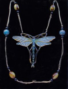 Carved horn, René Lalique, dragonfly necklace.