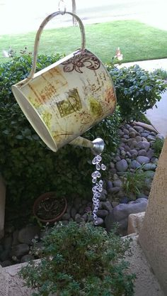 Gorgeous watering can decoration. Strung teardrop crystal beads from decorative watering can with fishing line and hung above a plant for added effect!!!