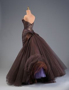 "What an amazingly cheeky petticoat detail to such a sophisticated dress. The Metropolitan Museum of Art - ""Butterfly"" Charles James"