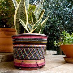 How to decorate a plastic flower pot using yarn leftovers.