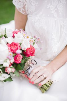 Great shot to capture the detail on the front of the dress, the ring, bouquet & wedding nails!