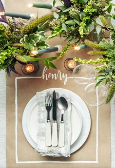 "Grab a white paint marker to create this ""place card/place mat"" combo on plain kraft paper. Round out the no-frills setting with a marble charger (shopterrain.com) and an ivory-colored plate (restorationhardware.com), then add a hint of sparkle with silver-flecked linens (canvashomestore.com) and pretty acrylic flatware (anthropologie.com). How to make the paint marker place mat: Cut an 18-inch-wide piece of kraft paper to desired runner length. In pencil, lightly draw three sides of a…"