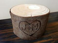 This is a candle holder BUT I thought itd be pretty awesome if you had a tree stump like this with J & W engraved in a heart or something & had your wedding cake on top of it!!!