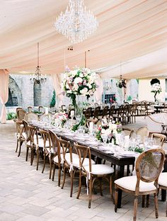 Long Wooden Tables with Tall and Short Centerpieces | Brides.com