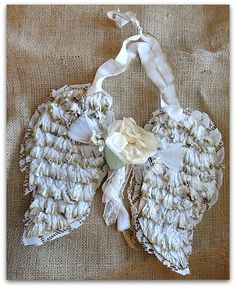 Crepe paper ruffled angel wings with vintage milinery. would make a lovely vintage ornament for Christmas tree