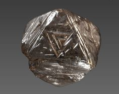 Diamond 55745 / diamond (crystal, silver-gray, octahedron) Mbuji-Mayi, Kasaï-Oriental (East Kasai), Democratic Republic of Congo. Photo: The Natural History Museum of Los Angeles County