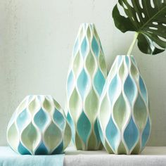 Our Blue Waves Vases come in sets of three bright colored vases whose design allows the imitation of the waves to come alive in your home | domino.com