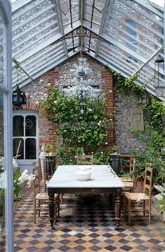 Conservatory with antique table and chandelier