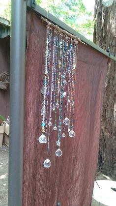 I just finished this sun catcher wind chime, with Swarovski crystals, quartz crystals, copper wire wrapped branch, glass and crystal beads, as garden art, or maybe a window charm. I'm also posting a close-up so you can see the colors better. - Monica Lucas
